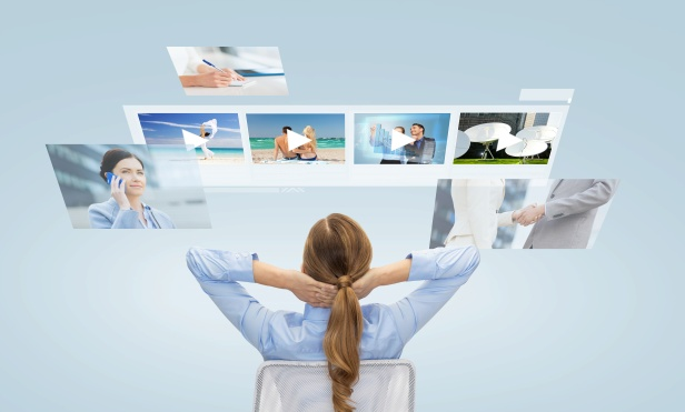 businesswoman watching video media files